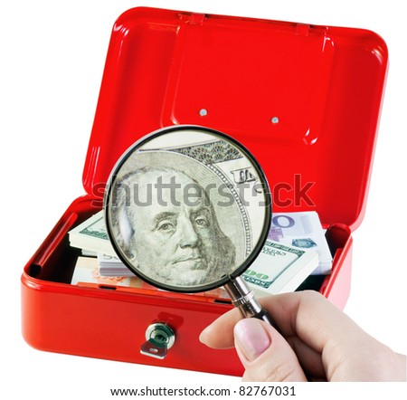 examines and counts the money in a moneybox - stock photo