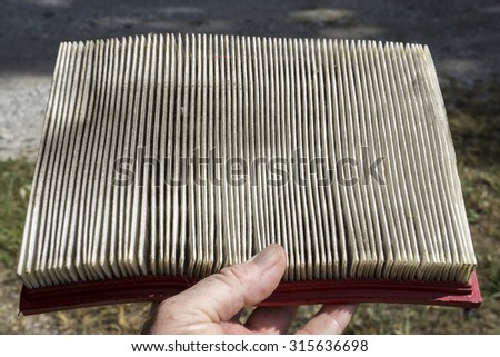 Examining a air filter taken from a customer's truck. - stock photo