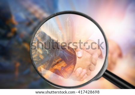 Examining business with magnifying glass, concept examining.