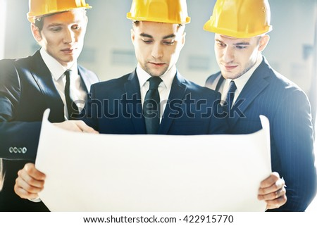 Examining construction plan - stock photo