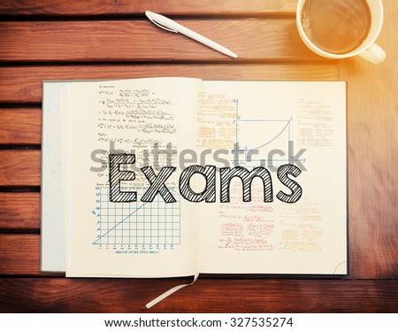 Exams : text inside notebook on table with coffee