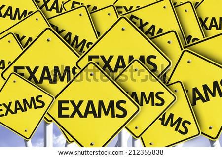 Exams written on multiple road sign  - stock photo