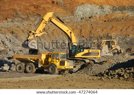 Excavation equipment moving the blasted rock during a large construction project in Roseburg Oregon