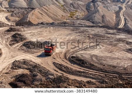 Excavation site with construction machine - stock photo