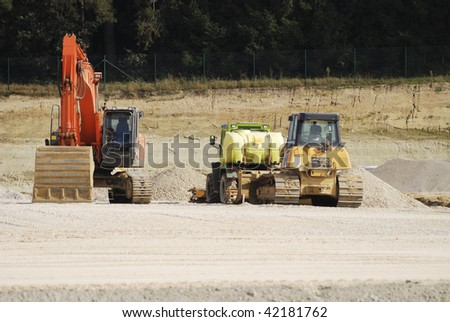 Excavator and other construction equipment.