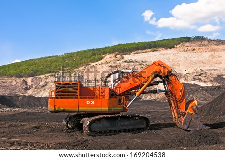 excavator at construction site - coal mine open pit machine bucket industry - stock photo