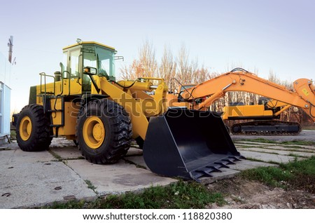 excavator at road construction work - stock photo