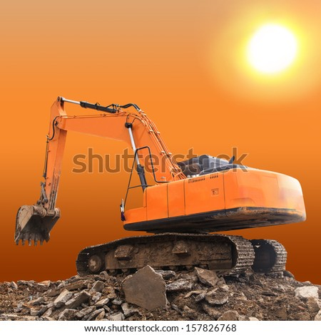 Excavator at sunset - stock photo