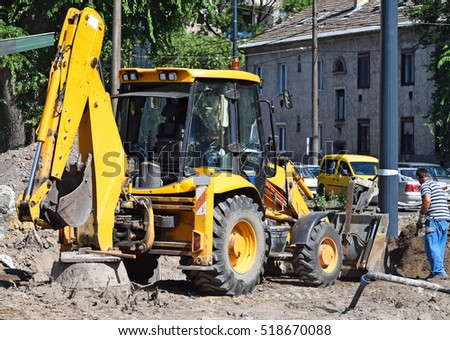 Excavator at the road construction