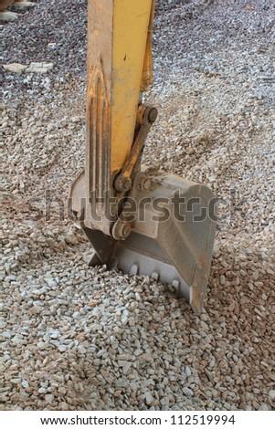 Excavator bucket closeup - stock photo
