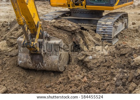 Excavator bucket closeup working at construction site - stock photo