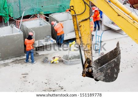 excavator bucket machine works outdoors - stock photo