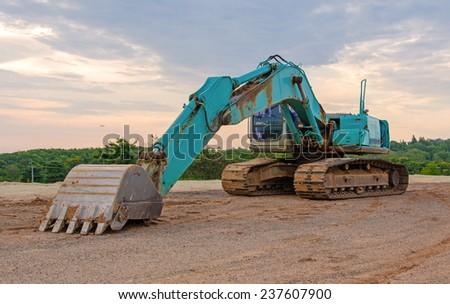 Excavator construction equipment park at worksite. - stock photo