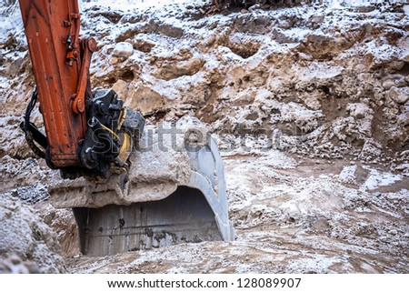 Excavator digging ground at day