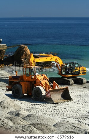 excavator / dredge at work / Reconstruction of a beach - stock photo