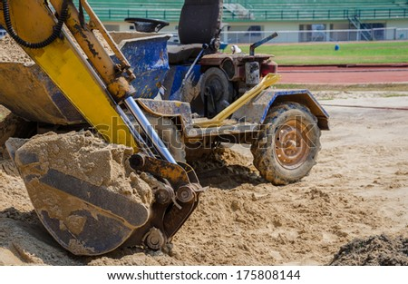 Excavator during earth moving works outdoors at sand quarry,Thailand - stock photo