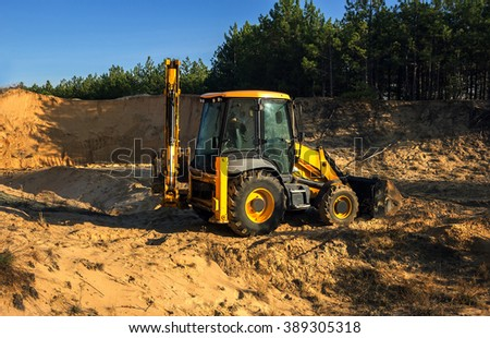 excavator illegally produces sand, destroying the forest landscape. ecological problem. - stock photo