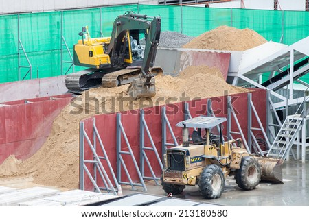 Excavator in a Construction site - stock photo