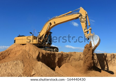 excavator in action on a construction site - stock photo