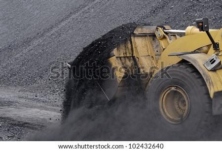 Excavator in coals. - stock photo