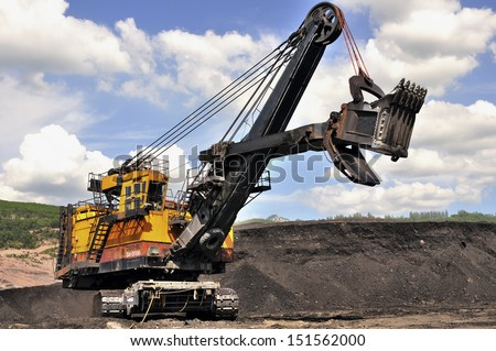 Excavator in the open-pit mine in northern Thailand - Mae Moh   - stock photo