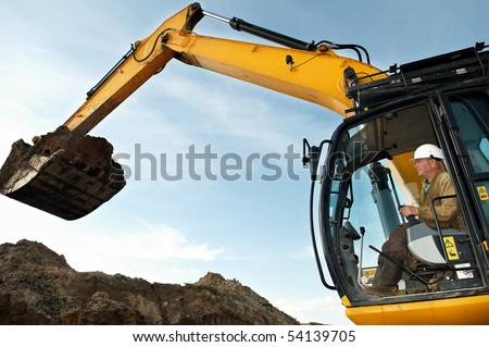 excavator loader driver working at construction building area - stock photo