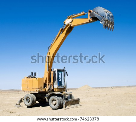 excavator loader during  works outdoors at construction site