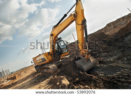 Excavator loader excavating soil from sandpit in summer - stock photo