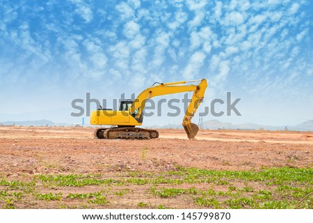 excavator loader machine during earthmoving works outdoors - stock photo