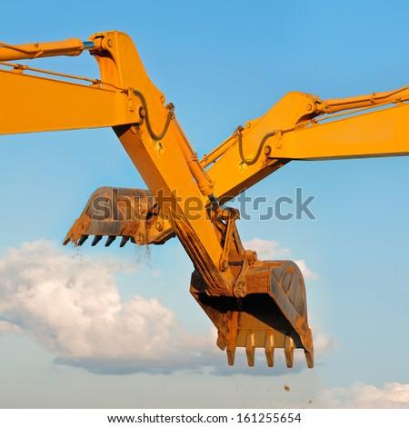Excavator loader machine on blue sky background.  - stock photo