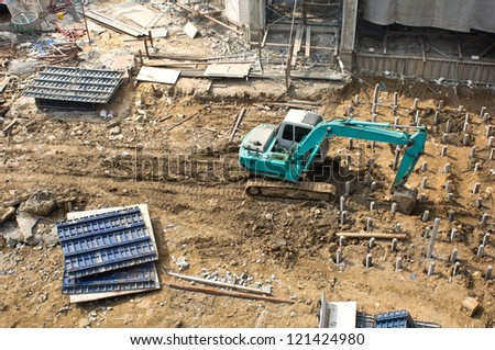 Excavator loader machine works outdoors at construction site - stock photo