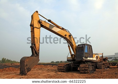 Excavator Loader with backhoe standing in sandpit - stock photo