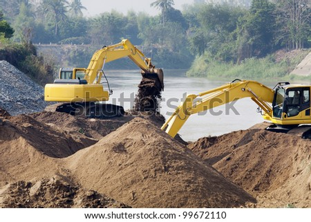 excavator machine group works at river for protect flood - stock photo