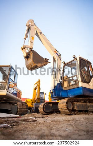 Excavator machines  on the construction site - stock photo