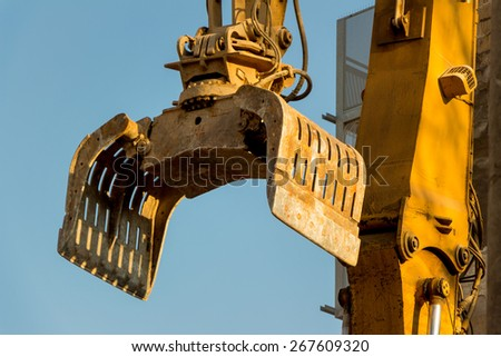 excavator on a construction site during the demolition of a hauses.platz for new housing and living space is required - stock photo