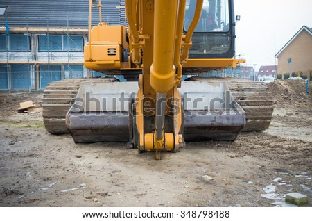 excavator on a construction site in the netherlands - stock photo