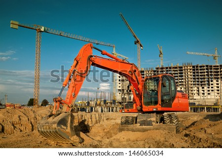 excavator on construction site - stock photo