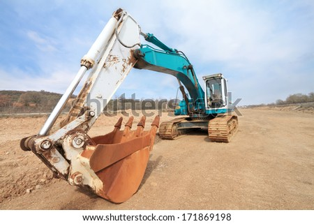 Excavator on road construction site. Wide angle view.