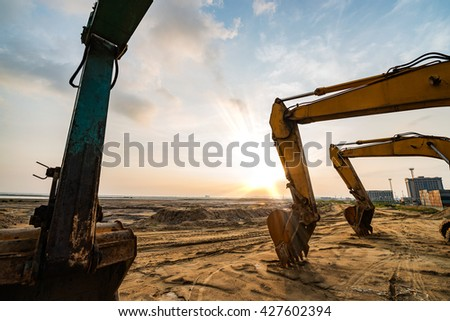 Excavator parked at the site - stock photo