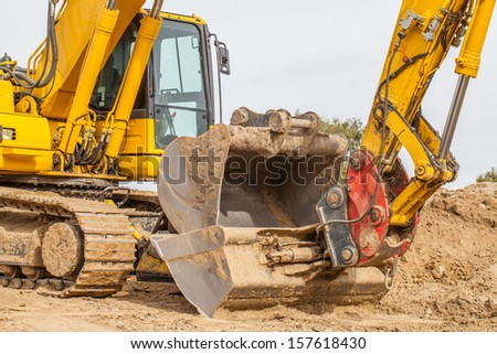 Excavator standing in the construction site. - stock photo