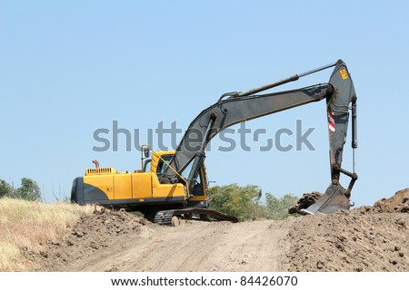 excavator work on road construction