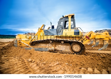 Excavator working and moving earth in construction site, highway road in construction - stock photo