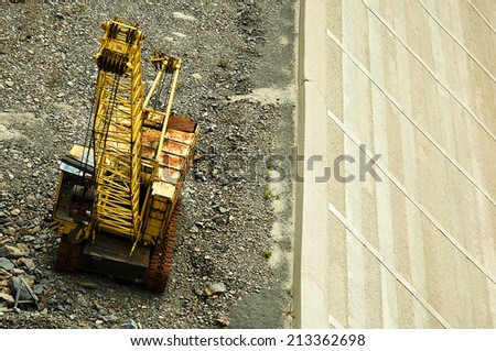 excavator working on site, vertical image