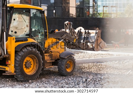 excavator working with crushed stone