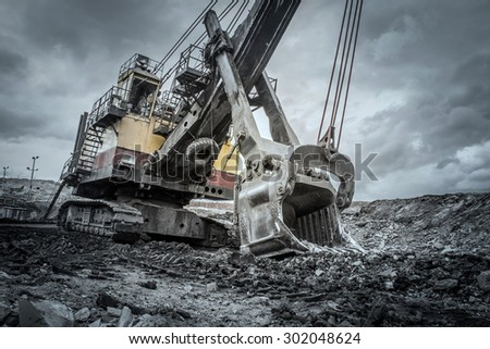 Excavators in coal mines, Mae Moh, Lampang, Thailand. - stock photo