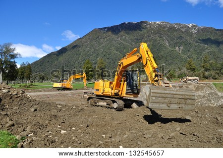 Excavators levelling a construction site in Westland