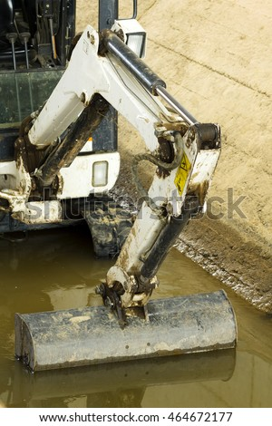 excavators to cleaning the water canals for traditional  irrigation in  crop fields , Leon, Spain