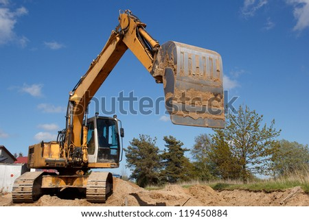 excavators working on a construction site - stock photo