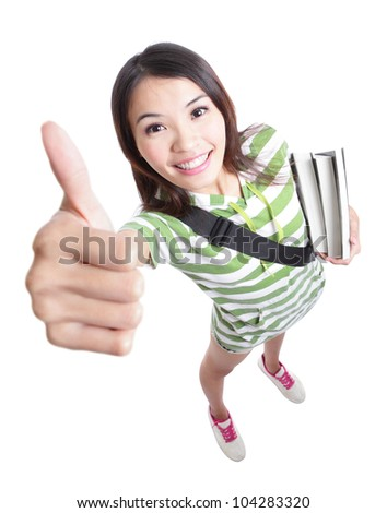 excellence - girl student thumbs up hand gesture with smile in full length and high angle view isolated on white background, model is a asian woman - stock photo
