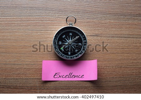 Excellence : Motivation advice handwriting on label with compass - stock photo